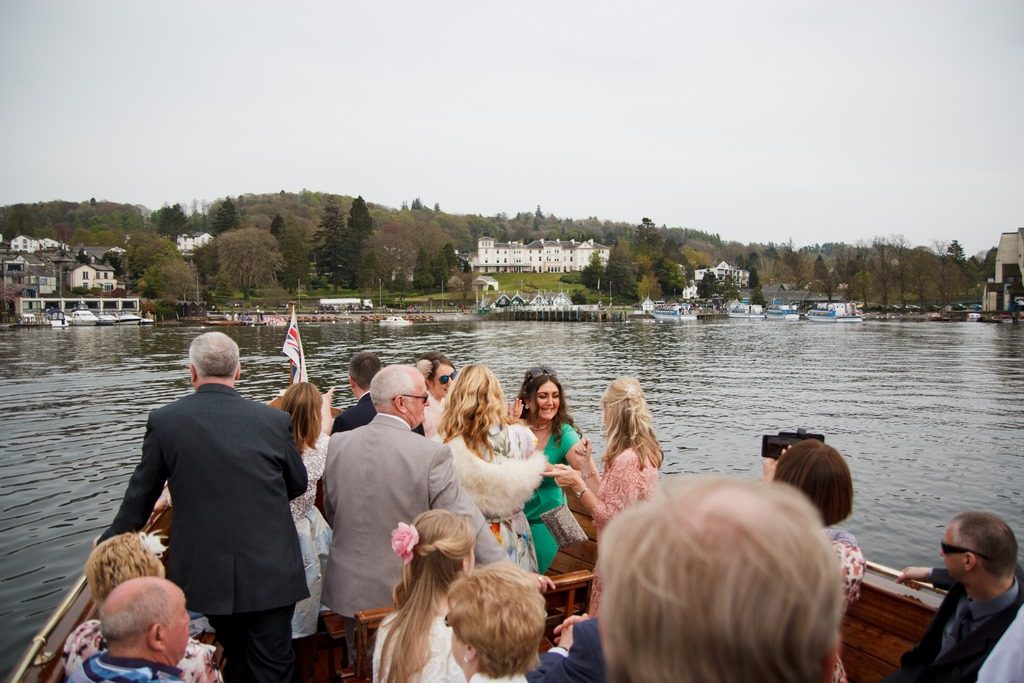 guests standing on boat as it arrives near the belsfield hotel